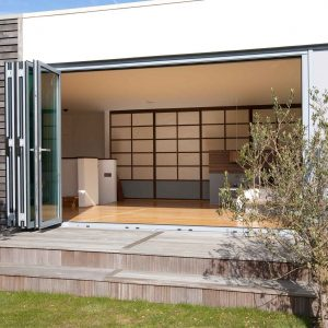 Aluminium bi-folding doors leading out onto the garden