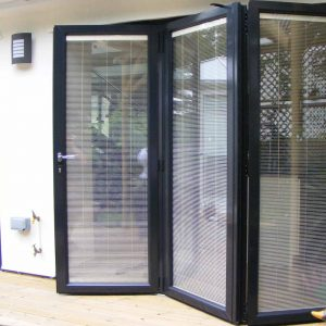 Black aluminium bifold door with integral blinds
