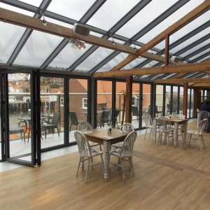 Black aluminium bifold door design and installation for Restaurant