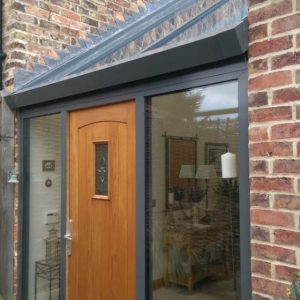 Timber effect composite door and aluminium entrance hall