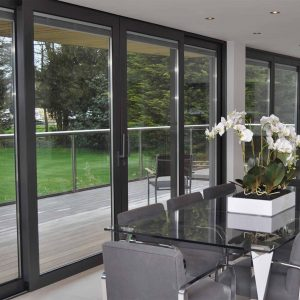 Black aluminium sliding patio door with integral blinds