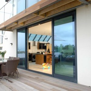 Aluminium sliding patio door leading onto decked patio area