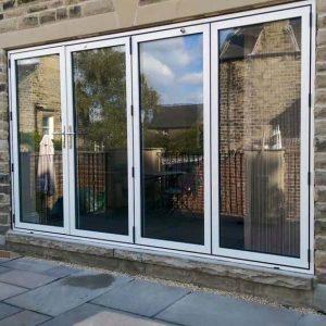 White aluminium bifold doors installation